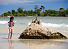 Sandcastle Photo: On Victory Beach, a young Cambodian girl builds a sandcastle on a rock.  It's a scientifically verifiable fact that Cambodian kids are the cutest children on earth... it's science and therefore, can't be disputed.