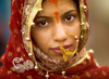 Hindu Bride Photo: A beautiful Indian bride receives blessings from the Ganges river before entering into matrimony.