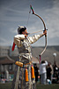 photo: Markswoman - The archery portion of the Naadam Festival held in July each year.  A female archer in elegant Mongolian dress aims to topple a small wall of marked blocks from over half a football field away.  The skill demonstrated by the archers in the competition is absolutely amazing as they more often than not hit the center portion of the marked blocks.  What's even more amazing, to me at least, is that they arc the arrows at the target as you can see from the position of this archer's bow, yet still manage to hit the target consistently.
