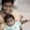 photo: Baby Earrings - A mother and child sit on the beach and graciously comply to my photo request.