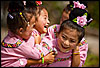 Four of a Kind Photo: Ethnic Miao girls yuk it up before their traditional dance practice.
