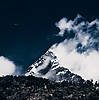 Thermals (Machapuchre Part I) Photo: A paraglider drifts in the sky with the Himalayan mountain, Machapuchre, for a backdrop.  The photo was taken from the valley in Pokhara.