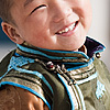 Traditional Vest Photo: A young Mongolian boy dressed in ceremonial garb.