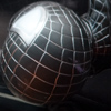 Sticky Venom Photo: Spiderman's alter ego, Venom, hangs comfortably on the inside of a motorcycle windshield.