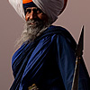 Gurdwara Head Photo: The leader (or head) of the Paonta Sahib Gurdwara appears menacing with weapons drawn.  Contrary to the impression left by this image, this man, like most Sikhs I've met, is one of the classiest, kindest, gentlemen in all of India.  Despite the fierce stance, you can see the gentle grin poking through his salt and pepper beard.