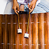 Percussion Perspective Photo: A young girl plays a Thai traditional instrument called a ranat ek (ระนาดเอก).