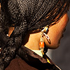 photo: Braided - A Tibetan woman's intricately braided hair.