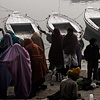 Varanasi Vessels Photo: Hindu pilgrims prepare for a dawn boat ride on the Ganges river.