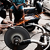 photo: Door To Door Sharpener - A Delhi man uses his ingeniously rigged bicycle to sharpen knives from restaurant to restaurant.