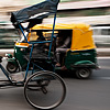 photo: Roti-Powered - A cycle rickshaw driver offers a quick glance in busy downtown traffic.