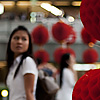 Paper Balls Photo: A Thai student passes an ornamental red lantern that decorates the walkway at the Paragon Mall.