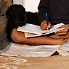 Well Grounded Photo: A boy and his goat put the finishing touches on homework before the start of school.