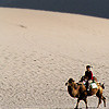 Camel Jockeys Photo: Chinese tourists take double-humped camels out for a spin around the Singing Sand Dunes of Dunhuang.
