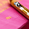 photo: Gold Code - A shuttle rests on an unfinished silk saree.