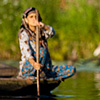 Paddling Pairs Photo: Two boating women approach one another on the back waterways of Dal Lake.