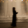 photo: Water Works - A female Arab tourist walks in front of a fountain at Kuala Lumpur City Center (KLCC).
