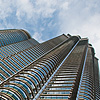 Cloud Chafers (Panorama) Photo: Bottom-up view of one of the Petronas Twin Towers.