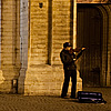 Street Symphony Photo: A street violinist performs outside the entrance of the Cathedral of Our Lady.