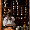 photo: Striking Shopkeeps - A silver and copper goods salesman sits idle on a slow business day.