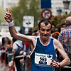26.2 Photo: A marathon runner gestures as he approaches the finish line near Grote Markt.