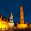 Downtown Dusk Photo: A statue in Grote Markt is backed by the provincial courthouse and belfry.