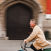 Saddlebags Photo: Panned photo of a bicyclist in front of Grote Markt's belfry.