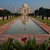 Taj Digital Gardening Photo: A distant view of the Taj Mahal at sunrise reflected in the first of two fountains. (From the archives due to time restraints.)
