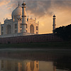 Monolithic Monument Photo: The Taj Mahal, seen from the holy Jamuna river, is reflected on the water's surface at sunset.  (From the archives due to time restraints.)