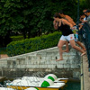 Deep Leap Photo: French teens jump from a bridge into beautiful Annecy lake.
