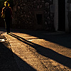 Evening Shadow Photo: Woman and shadow in an ancient alleyway near old town.