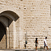 Rampart Roamers Photo: Tourists wander around the fortification of the old city of Aigues Mortes.