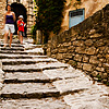 Bouldery Boulevard Photo: Tourists climb down a hilly stone path of Gordes, a picturesque Provencal village.