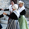 Period Performance Photo: Traditionally dressed women in period costume perform a dance at the church square.