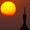 Sunni Sky Skewers Photo: A mosque's minaret in Islamic Cairo at sunset.