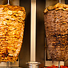 photo: Shaved Meats - Chicken and lamb shawerma meats rotate on a skewer.