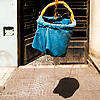 Drop Delivery Photo: A hanging basket lowered from an apartment window.