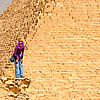 Pyramids People (Panorama Inside) Photo: A young Egyptian girl laughs with a friend near the Pyramid of Khufu (Cheops in Greek).