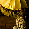 photo: Parasol Protection - A Hindu statue under an ornate umbrella (ARCHIVED PHOTO on the weekends - originally photographed 2006/10/10).