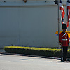 Thai Royal Guard Photo: A Thai Royal guard near the wall of the National Palace awaits the arrival of the King of Thailand.