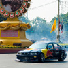Bangkok Formula One Photo: A Red Bull stunt car takes a few hazardous laps around Ratchadamnoen street at over 100mph.