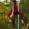 Street Performer Festival Acrobatics Photo: A woman performs dance-like maneuvers suspended in mid-air.