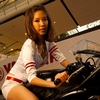"Yamaha Motorcycle Models Photo: A beautiful Thai model straddles a crotch-rocket at the Yamaha booth at the ""Harley-Davidson"" motorcycle show in Bangkok."