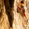 Railay Rock Climbing Photo: A female rock-climber framed by stalactites.