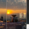 Lebua Sky Bar Sunset Photo: A beautiful sunset reflection from the Lebua sky bar at the State Tower in Bangkok.