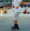 Vientiane Evening Recreation Photo: A moving pan of a Laotian inline-skater on the promenade at sundown in Vientiane.