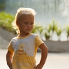 Li'l Fashion Model Photo: A young tourist girl unleashes impromptu runway modeling outside the Paragon Mall in Bangkok.