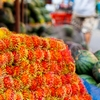photo: Hairy Heap - A neatly piled stack of rambutan fruits at a local market in Bangkok.