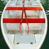 Hourly Hire Photo: Red rowboat ready for hire on Annecy Lake.