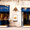 Annecy Arch Photo: A beautifully blue storefront seen through an arch in the historic old town of Annecy.