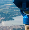 Lakeside Canton Photo: A coin-operated set of binoculars overlooks the city of Geneva from the Saleve viewpoint in France.